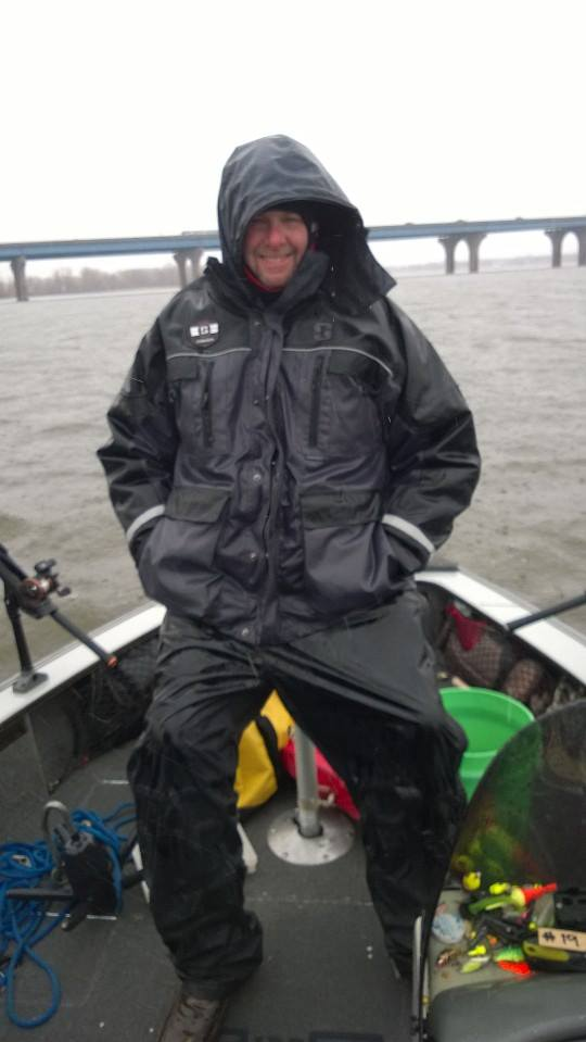 Mark Schram sits in the rain during the Swamp Donkey Walleye Tournament